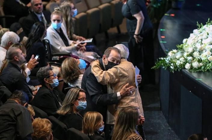 Dr. Jose A. Gonzalez is embraced during funeral services for his son, Edgar Gonzalez, at Christ Fellowship Church in Palmetto Bay on Friday, July 23, 2021. Edgar Gonzalez died during the collapse of the 12-story oceanfront condo, Champlain Towers South in Surfside.