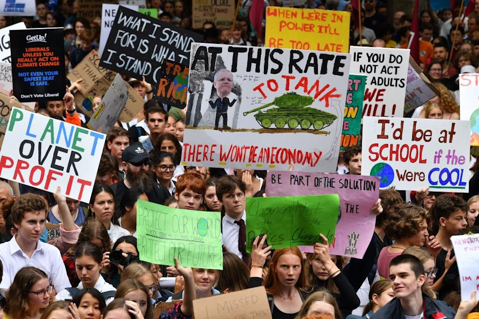 School children shout slogans during a strike and protest by students highlighting inadequate progress to address climate change in Sydney on March 15, 2019. (Photo by SAEED KHAN/AFP/Getty Images)