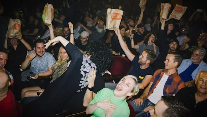 """Audience at """"Showgirls"""" in San Francisco in the documentary """"You Don't Nomi."""" <span class=""""copyright"""">(RLJE Films)</span>"""