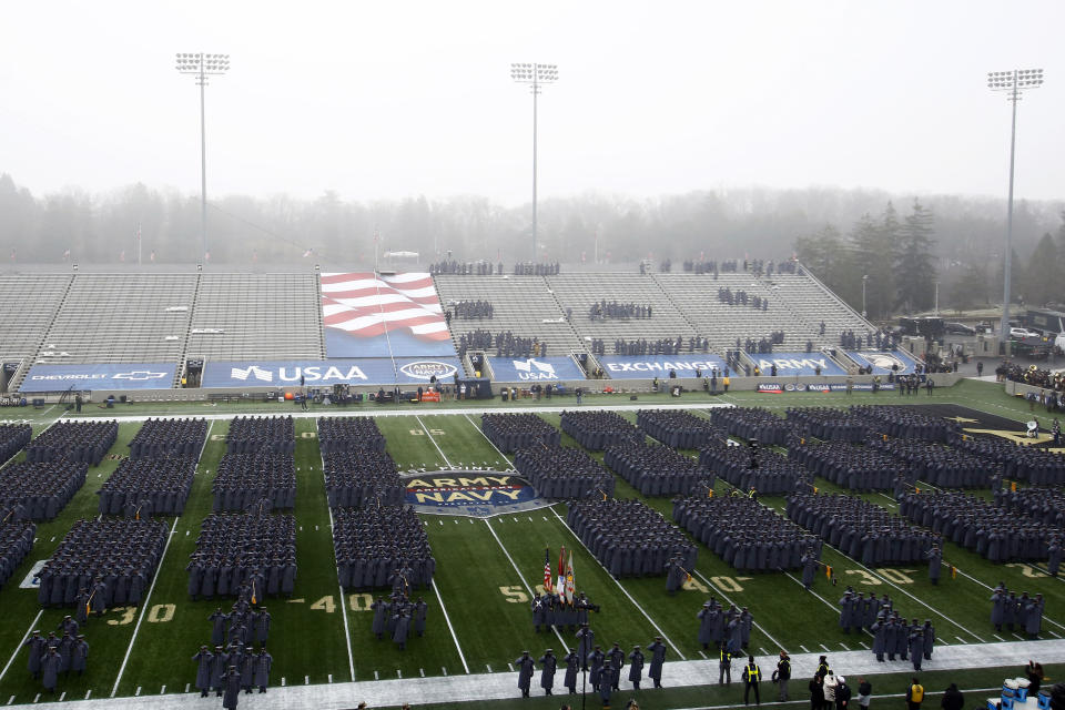 FILE - Army cadets march on the field before an NCAA college football game against Navy in West Point, N.Y., in this Saturday, Dec. 12, 2020, file photo. Bump Army-Navy or go head-to-head with NFL? That's the choice facing those in charge with expanding the College Football Playoff if they want to take the format from four to 12 teams. (AP Photo/Adam Hunger, File)