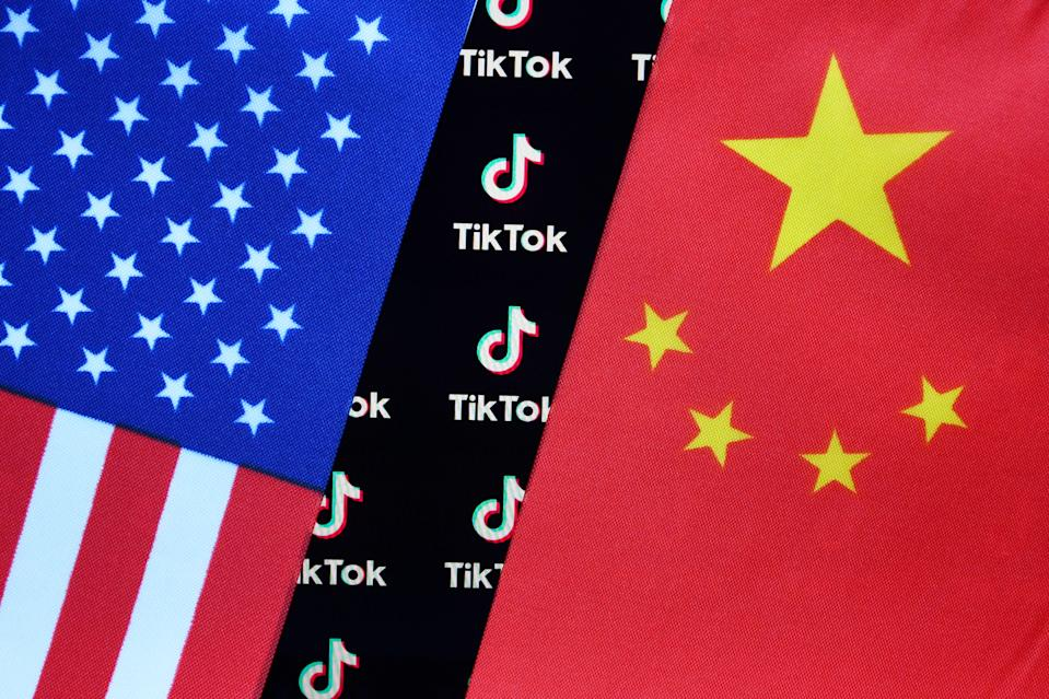 CHINA - 2020/08/05: In this photo illustration, a TikTok logo is seen displayed on a smartphone with a Chinese American flag in the background. (Photo Illustration by Sheldon Cooper/SOPA Images/LightRocket via Getty Images)