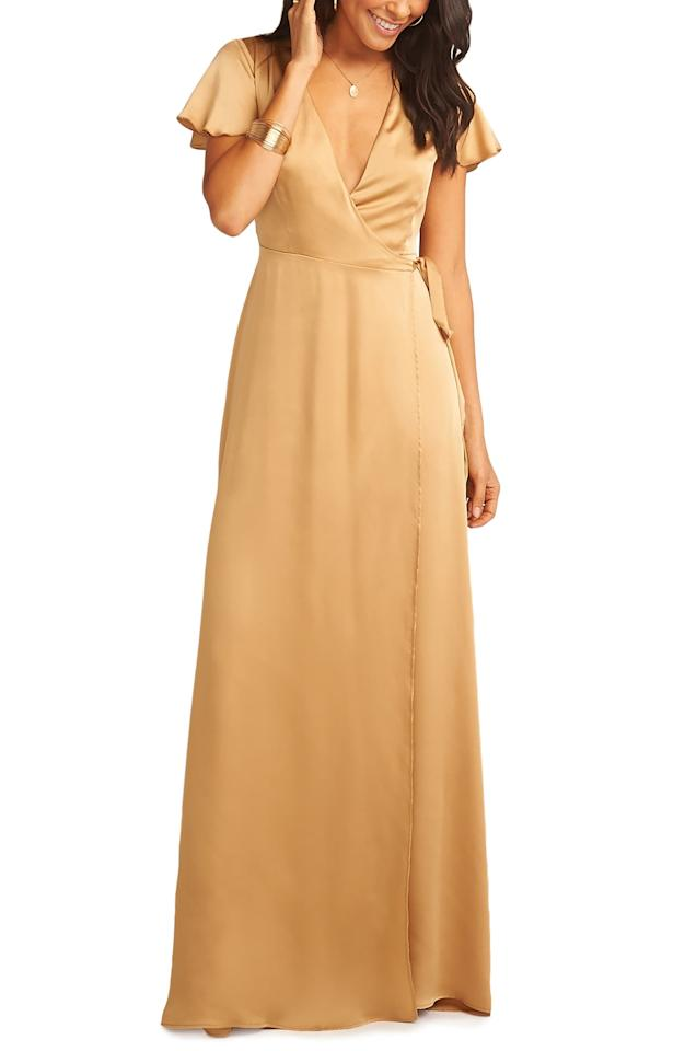 """<p>Looking for something luxe? Get this <a href=""""https://www.popsugar.com/buy/Show-Me-Your-Mumu-Noelle-Satin-Wrap-Evening-Dress-410511?p_name=Show%20Me%20Your%20Mumu%20Noelle%20Satin%20Wrap%20Evening%20Dress&retailer=shop.nordstrom.com&pid=410511&price=216&evar1=fab%3Aus&evar9=45750159&evar98=https%3A%2F%2Fwww.popsugar.com%2Fphoto-gallery%2F45750159%2Fimage%2F45750302%2FShow-Me-Your-Mumu-Noelle-Satin-Wrap-Evening-Dress&list1=shopping%2Cwedding%2Cdresses%2Cbridesmaids%2Cbridesmaid%20dresses%2Cwedding%20guest%20dresses&prop13=api&pdata=1"""" rel=""""nofollow"""" data-shoppable-link=""""1"""" target=""""_blank"""" class=""""ga-track"""" data-ga-category=""""Related"""" data-ga-label=""""https://shop.nordstrom.com/s/show-me-your-mumu-noelle-satin-wrap-evening-dress/5200206?origin=category-personalizedsort&amp;breadcrumb=Home%2FWomen%2FClothing%2FDresses%2FBridesmaid&amp;color=true%20gold%20luxe%20satin"""" data-ga-action=""""In-Line Links"""">Show Me Your Mumu Noelle Satin Wrap Evening Dress</a> ($216) in gold.</p>"""