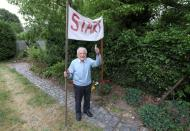 Alfons Leempoels walks the equivalent of a marathon in his garden to raise money to fight against the coronavirus disease (COVID-19) in Rotselaar