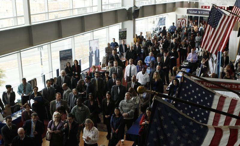Job applicants listen to a presentation prior to the opening of a job fair held by the U.S. Chamber of Commerce and the Washington Nationals baseball club in Washington