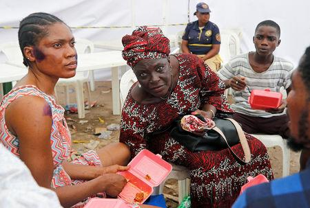 A rescued woman is pictured during counselling at the site of a collapsed building in Nigeria's commercial capital of Lagos, Nigeria March 15, 2019. REUTERS/Afolabi Sotunde