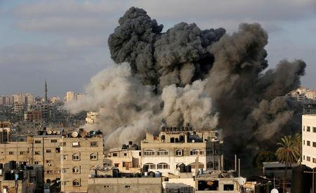 Smoke rises after an Israeli aircraft bombed a multi-storey building in Gaza City