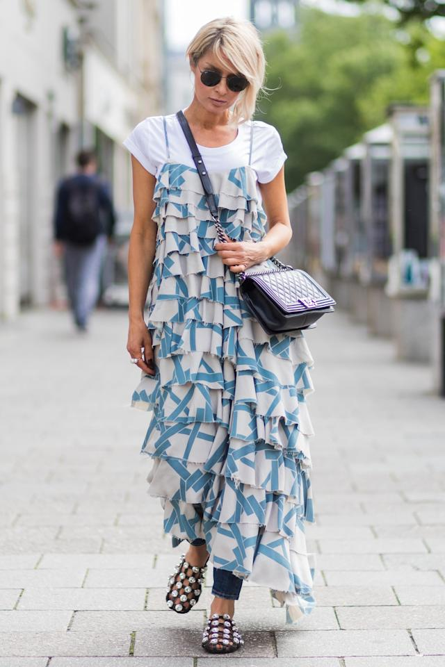 <p>Dress down the most fancy of looks by slipping a classic white tee underneath a printed or layered maxi dress.</p>