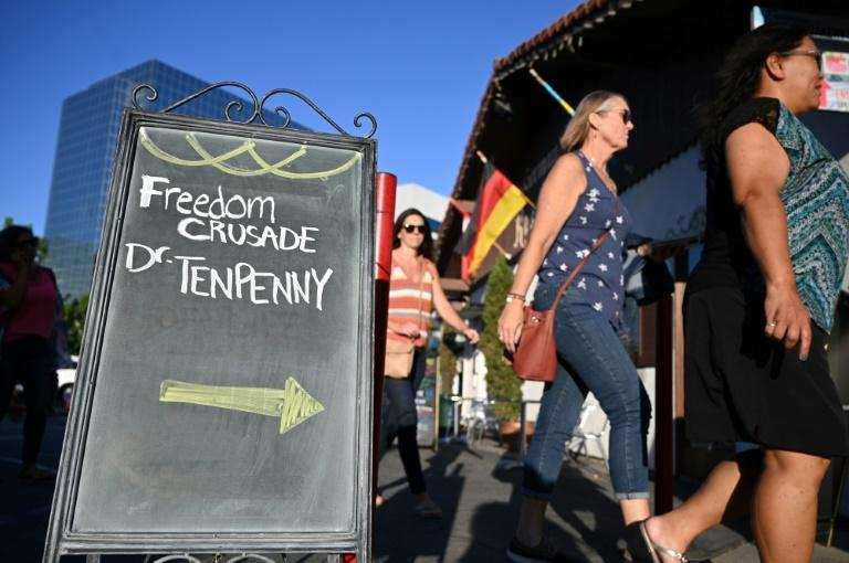 """People arrive to hear Doctor Sherri Tenpenny speak at a """"Freedom Crusade"""" event on August 5, 2021, in Huntington Beach, California (AFP/Robyn Beck)"""