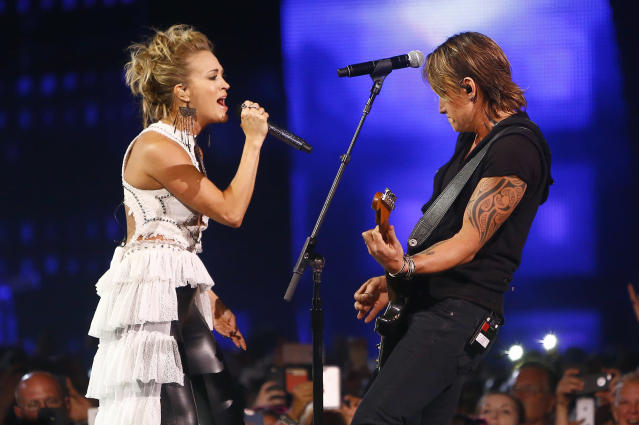 """<p>Carrie Underwood and Keith Urban perform """"The Fighter"""" at the CMT Music Awards at Music City Center on Wednesday, June 7, 2017, in Nashville, Tenn. (Photo by Wade Payne/Invision/AP) </p>"""