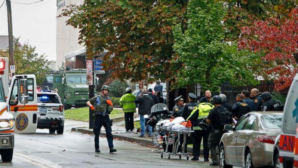 PHOTO: First responders surround the Tree of Life Synagogue in Pittsburgh where a shooter opened fire, Oct. 27, 2018. (Gene J. Puskar/AP)