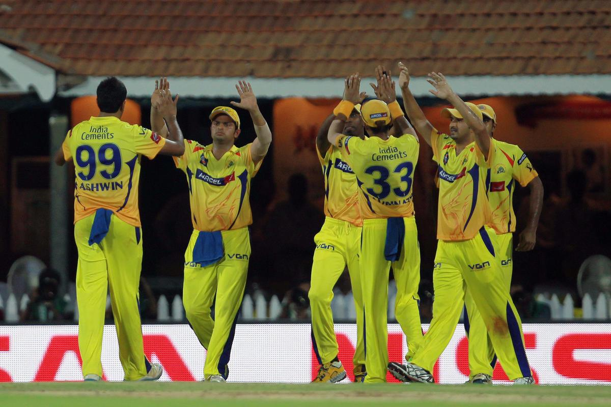 Ravichandran Ashwin and Dwayne Bravo are congratulated by their teammates after taking the wicket of David Hussey during match 45 of the Pepsi Indian Premier League between The Chennai Super Kings and the Kings XI Punjab held at the MA Chidambaram Stadium in Chennai on the 2nd May 2013. Photo by Jacques Rossouw-IPL-SPORTZPICS    .. .Use of this image is subject to the terms and conditions as outlined by the BCCI. These terms can be found by following this link:..https://ec.yimg.com/ec?url=http%3a%2f%2fwww.sportzpics.co.za%2fimage%2fI0000SoRagM2cIEc&t=1506197971&sig=iUTDCJlHRc48n8jWgIzuWg--~D