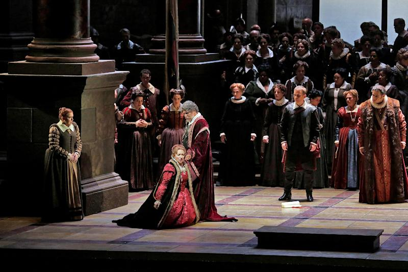 """In this March 11, 2013 photo provided by the Metropolitan Opera, Krassimira Stoyanova kneels in the role of Desdemona opposite Jose Cura in the title role during a performance of of Verdi's """"Otello,"""" at the Metropolitan Opera in New York. (AP Photo/Ken Howard)"""