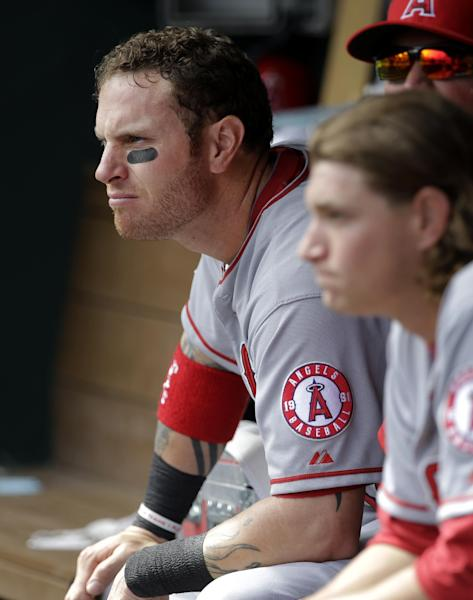Los Angeles Angels' Josh Hamilton, left, and Garrett Richards, right, sit in the dugout in the eighth inning of a baseball game against the Texas Rangers, Friday, April 5, 2013, in Arlington, Texas. Hamilton was a five-time All-Star and the 2010 AL MVP while with Texas before going to the AL West-rival Angels with a $125 million, five-year contract over the winter. He finished 0 for 4, he was booed when he was introduced, then cheered when he struck out twice.(AP Photo/Tony Gutierrez)