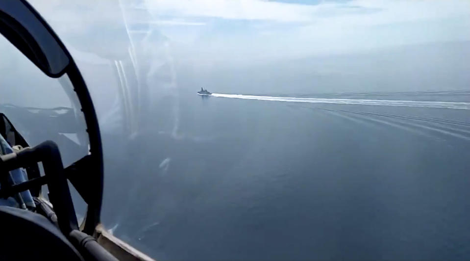 In this grab taken from a video released by the Russian Defense Ministry Press Service on Wednesday, June 23, 2021, a view of the British destroyer HMS Defender as it sails near Crimea in the Black Sea. The Russian military has launched sweeping maneuvers in the Mediterranean Sea featuring warplanes capable of carrying hypersonic missiles, a show of force amid a surge in tensions following an incident with a British destroyer in the Black Sea. (Russian Defense Ministry Press Service via AP)
