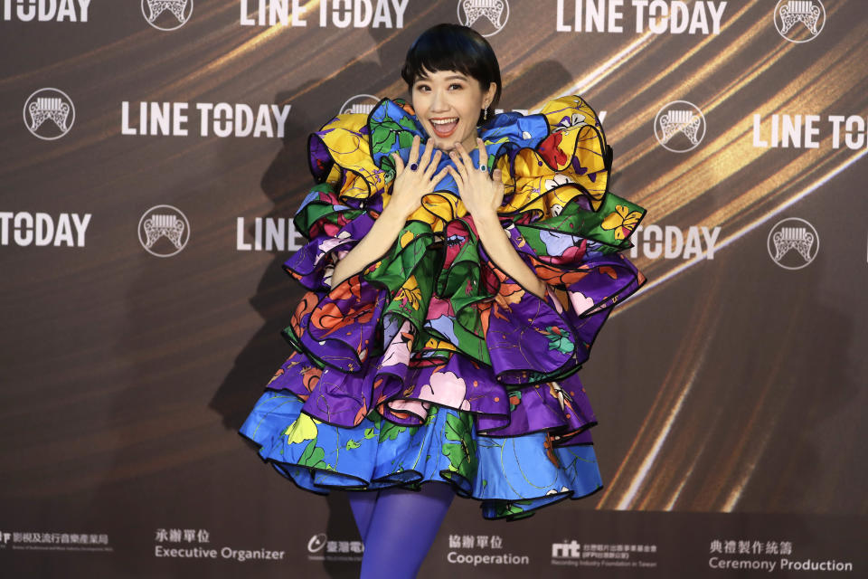 Taiwanese singer Huang Lu Tzu Yin smiles as she arrives for the 32nd Golden Melody Awards in Taipei, Taiwan, Saturday, Aug. 21, 2021. Golden Melody Awards, one of the world's biggest Chinese-language pop music annual events and postponed from June to Aug. due to the coronavirus pandemic. (AP Photo/Chiang Ying-ying)