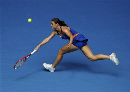 Vesna Dolonc of Serbia hits a return to Serena Williams of the U.S. during their women's singles match at the Australian Open 2014 tennis tournament in Melbourne January 15, 2014. REUTERS/Jason Reed