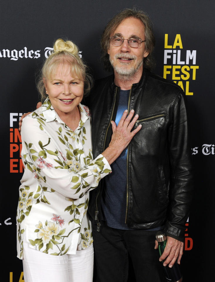"""Musicians Michelle Phillips, left, and Jackson Browne pose together at the premiere of the documentary film """"Echo in the Canyon"""" on the opening night of the 2018 Los Angeles Film Festival, Thursday, Sept. 20, 2018, in Los Angeles. (Photo by Chris Pizzello/Invision/AP)"""