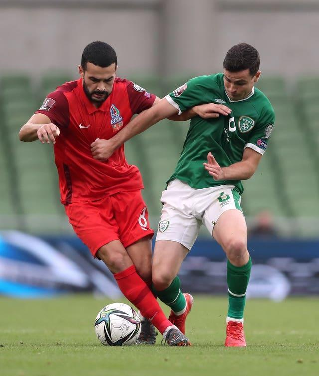 Republic of Ireland midfielder Josh Cullen (right) is refusing to give up on is qualification hopes