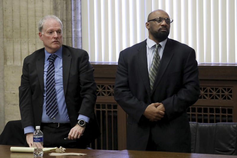 Shomari Legghette, right, and his attorney Scott Kamin, listens as the jury finds him guilty of first-degree murder in the Feb. 13, 2018, killing of Chicago Police Cmdr. Paul Bauer, Friday, March 13, 2020, at the Leighton Criminal Courthouse in Chicago. (Antonio Perez/Chicago Tribune via AP, Pool)