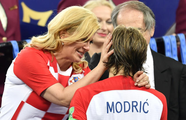Croatian President Kolinda Grabar-Kitarovic hugs Croatia's Luka Modric after France won the final match between France and Croatia at the 2018 soccer World Cup in the Luzhniki Stadium in Moscow, Russia, Sunday, July 15, 2018. (AP Photo/Martin Meissner)