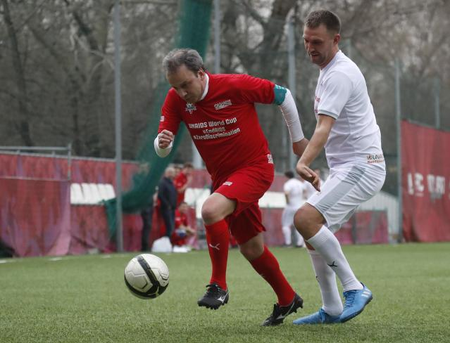Russian Deputy Prime Minister Arkady Dvorkovich (L) takes part in a soccer match between UNAIDS FC and Team Rosich, as part of the campaign to struggle against the AIDSs epidemic and discrimination, in Moscow, Russia April 17, 2018. REUTERS/Maxim Shemetov