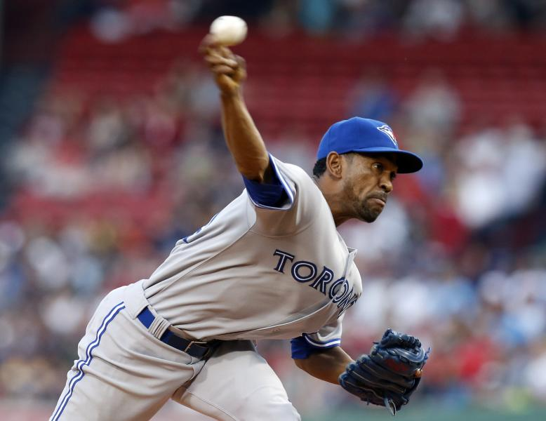 Toronto Blue Jays' Ramon Ortiz pitches in the first inning of a baseball game against the Boston Red Sox in Boston, Friday, May 10, 2013. (AP Photo/Michael Dwyer)