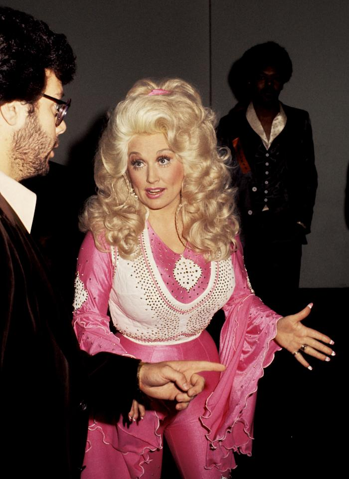 "Parton arrived at the 19th Annual Grammy Awards in 1977 in a can't-miss bedazzled leisure suit, doll-like makeup and signature bouffant hair. Although Parton went home empty handed that night, she picked up her first Grammy the next year for her song ""Here You Come Again."""