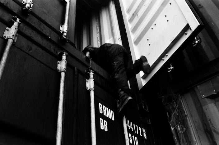 Mustafa, 11, climbs into a container heading for Melilla in the port of Tangier, Morocco, in 2003. (Photo: José Colón/MeMo for Yahoo News)