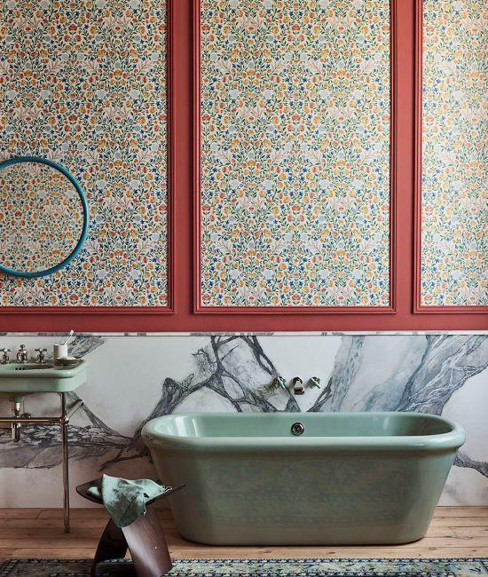 """<p>Throw out the rulebook, and embrace colours that clash. This bold bathroom by Cole & Son mixes natural grey marble with chalky green features and an Arts and Crafts-inspired wallpaper for a playful design scheme with heaps of character. Next time you are picking wallpaper samples, try going against the grain and experiment with clashing colour and print. </p><p>Pictured: <a href=""""https://www.cole-and-son.com/en/products/court-embroidery?v=3671"""" rel=""""nofollow noopener"""" target=""""_blank"""" data-ylk=""""slk:Court Embroidery"""" class=""""link rapid-noclick-resp"""">Court Embroidery</a>, Cole & Son</p>"""