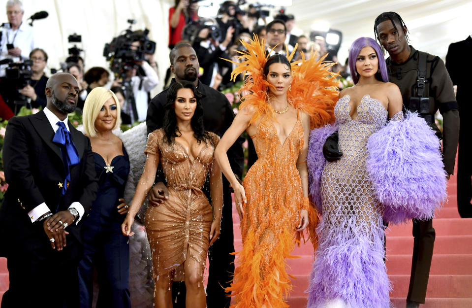 """FILE - Corey Gamble, from left, Kris Jenner, Kim Kardashian, Kanye West, Kendall Jenner, Kylie Jenner and Travis Scott attend The Metropolitan Museum of Art's Costume Institute benefit gala in New York on May 6, 2019. Their reality series """"Keeping Up with the Kardashians"""" will end the series with their 20th season. (Photo by Charles Sykes/Invision/AP, File)"""