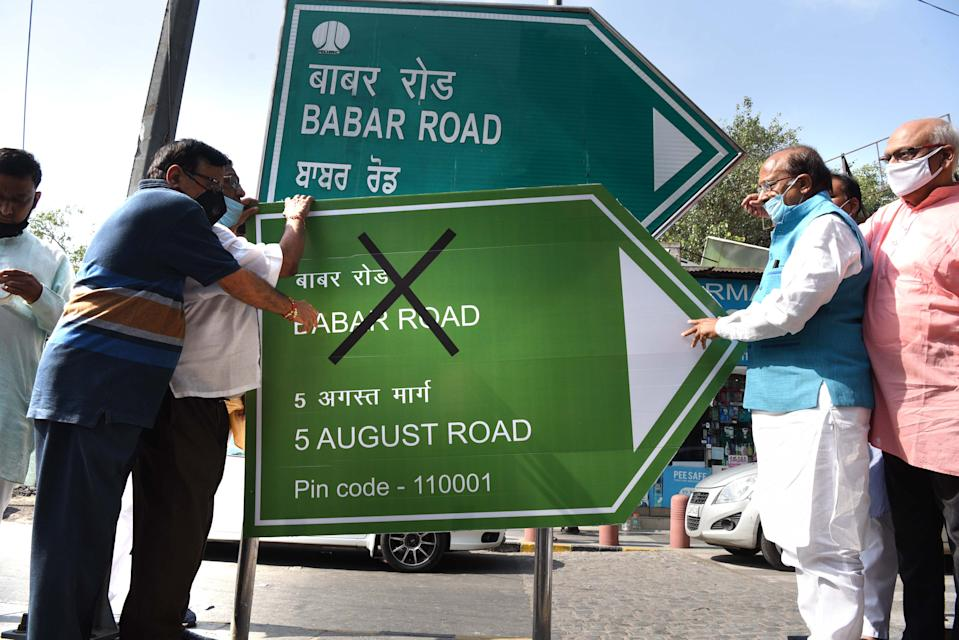 NEW DELHI, INDIA - AUGUST 4: BJP leader Vijay Goel, along with a group of supporters, pasted a poster reading 5 August Marg on a sign at Babar Road, at Bengali Market on August 4, 2020 in New Delhi, India. Goel has demanded that Babar Road, named after the Mughal ruler, should be renamed either to 5 August Marg or be named after an eminent personality. (Photo by Arvind Yadav/Hindustan Times via Getty Images)