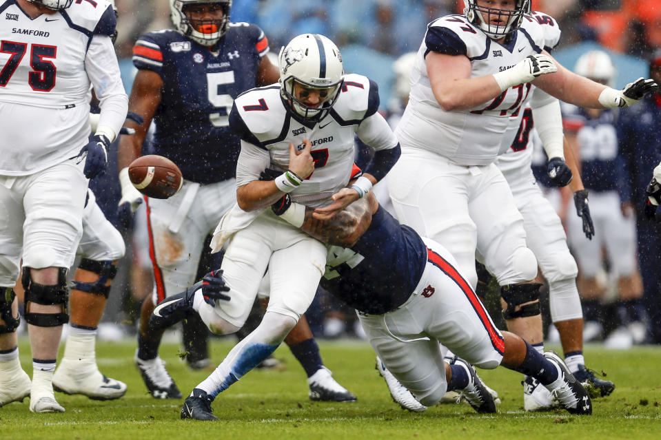 Samford quarterback Liam Welch (7) fumbles the ball as Auburn defensive tackle DaQuan Newkirk (44) delivers a hit during the first half of an NCAA college football game, Saturday, Nov. 23, 2019, in Auburn, Ala. (AP Photo/Butch Dill)