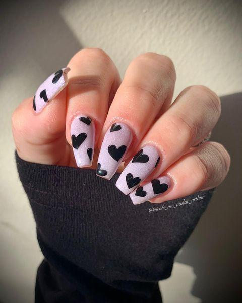 """<p>A black heart for V-Day can totally work when done right. Plus, this design works when it's not February 14th, too.</p><p><a href=""""https://www.instagram.com/p/CJtjRAsM03z/"""" rel=""""nofollow noopener"""" target=""""_blank"""" data-ylk=""""slk:See the original post on Instagram"""" class=""""link rapid-noclick-resp"""">See the original post on Instagram</a></p>"""