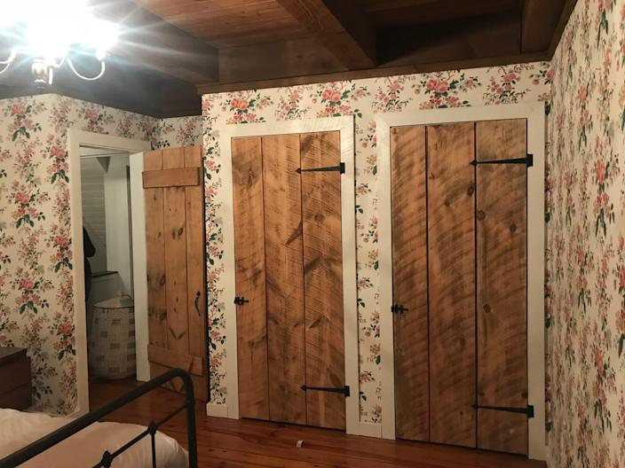 BEFORE: The doors, floors, and floral wallpaper in one of the guest bedrooms were kept in the renovation.