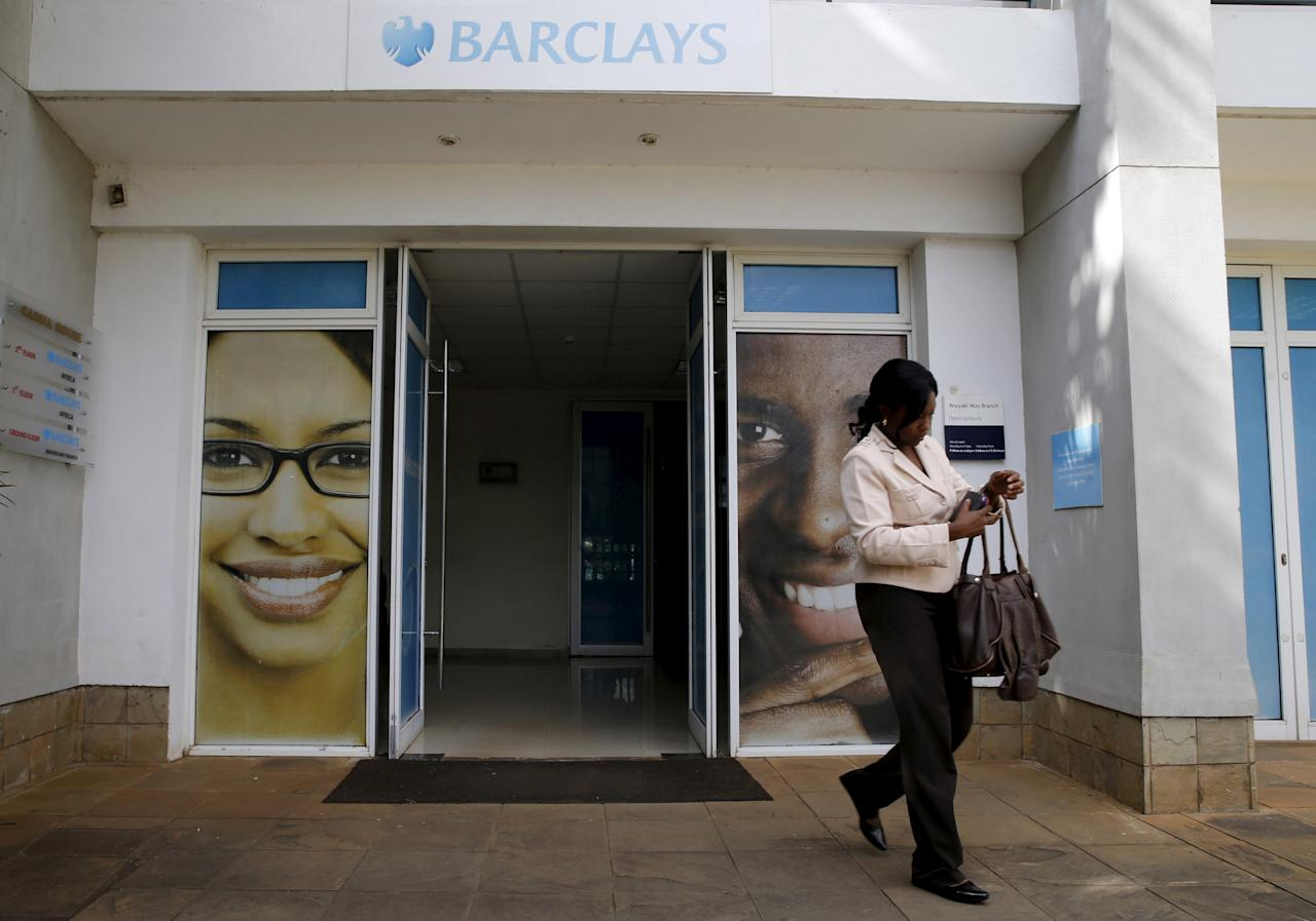A woman walks from a banking hall within the Barclays Bank Kenya head offices in the capital Nairobi, March 1, 2016.  REUTERS/Thomas Mukoya/File photo