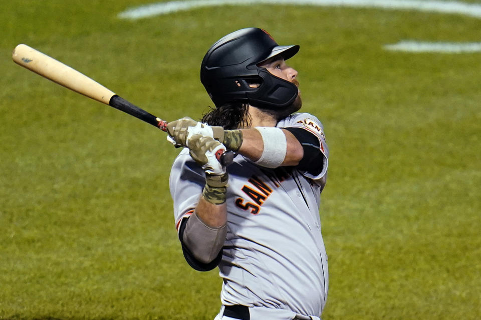 San Francisco Giants' Brandon Crawford watches his solo home run off Pittsburgh Pirates relief pitcher Duane Underwood Jr. during the eighth inning of a baseball game in Pittsburgh, Friday, May 14, 2021. (AP Photo/Gene J. Puskar)