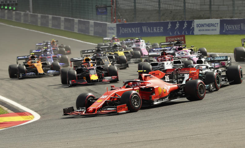 Ferrari driver Charles Leclerc of Monaco leads as the drivers steer their cars into the first corner during the Belgian Formula One Grand Prix in Spa-Francorchamps, Belgium, Sunday, Sept. 1, 2019. (AP Photo/Francisco Seco)