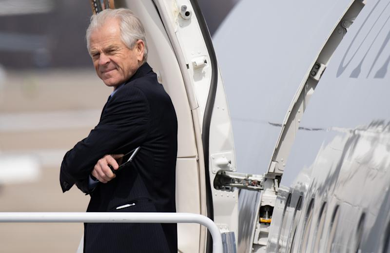 Peter Navarro, director of the Office of Trade and Manufacturing Policy, prepares to board Air Force One with US President Donald Trump prior to departure from Joint Base Andrews in Maryland, March 20, 2019, as he travels to visit a military manufacturing facility and attend a fundraiser in Ohio. (Photo by SAUL LOEB / AFP) (Photo credit should read SAUL LOEB/AFP/Getty Images)