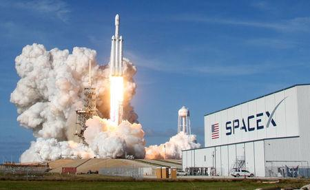 FILE PHOTO: A SpaceX Falcon Heavy rocket lifts off from the Kennedy Space Center in Cape Canaveral