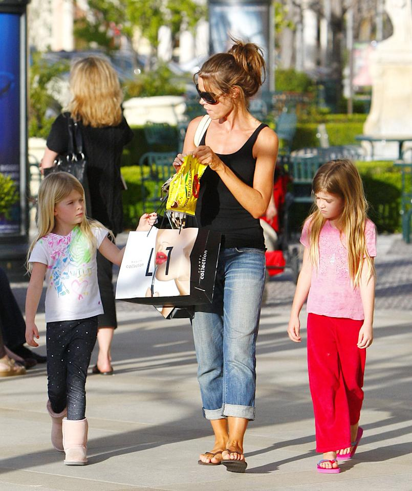 "In Calabasas, California, Denise Richards was spotted shopping and enjoying some Reese's Peanut Butter Eggs with daughters Lola and Sam. Karl Larsen/<a href=""http://www.infdaily.com"" target=""new"">INFDaily.com</a> - April 24, 2011"