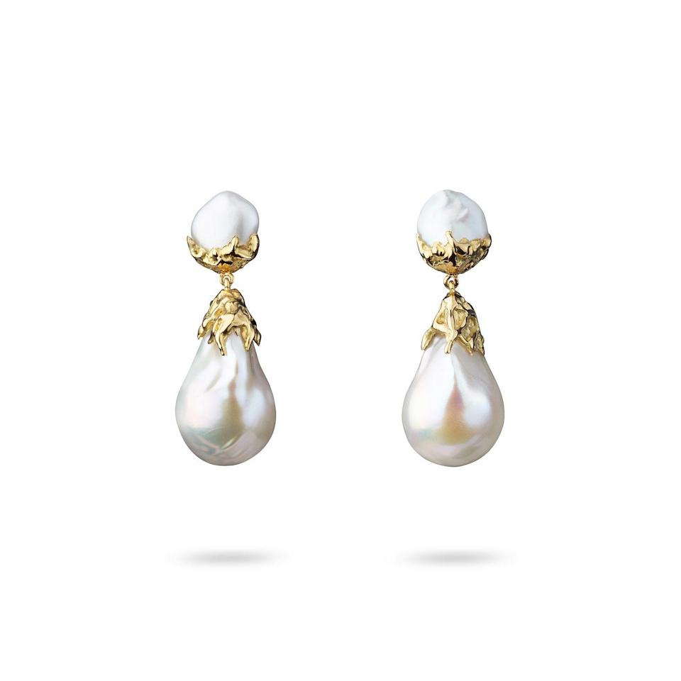 """<p><a class=""""link rapid-noclick-resp"""" href=""""https://www.jessiethomasjewellery.com/earrings/double-gold-pearl-earrings-small-baroque-version"""" rel=""""nofollow noopener"""" target=""""_blank"""" data-ylk=""""slk:SHOP NOW"""">SHOP NOW</a></p><p>Irregularly-shaped keshi (at top) and baroque (bottom) pearls give Jessie Thomas's handcrafted earrings a sensual, organic appeal. </p><p>Gold and pearl earrings, £850, Jessie Thomas</p>"""