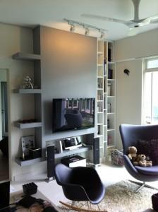 Accent wall in living room, with storage ledges on the side