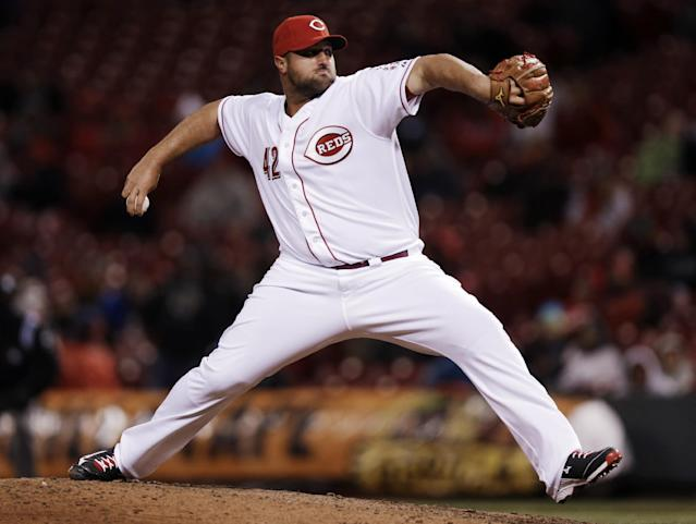 Cincinnati Reds relief pitcher Jonathan Broxton throws against the Pittsburgh Pirates in the ninth inning of a baseball game, Tuesday, April 15, 2014, in Cincinnati. Broxton earned his first save in Cincinnati's 7-5 win. (AP Photo/Al Behrman)