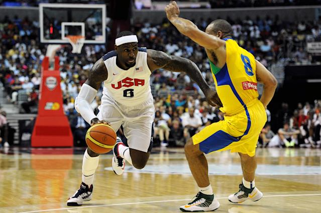 WASHINGTON, DC - JULY 16: LeBron James #6 of the US Men's Senior National Team dribbles past Alex Riberiro Garcia #8 of Brazil in the first quarter during a pre-Olympic exhibition basketball game at the Verizon Center on July 16, 2012 in Washington, DC. (Photo by Patrick Smith/Getty Images)