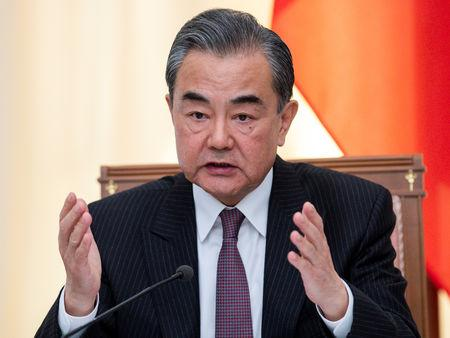 Chinese Foreign Minister Wang Yi speaks to the media at a news conference in Sochi