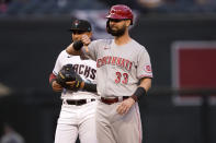 Cincinnati Reds' Jesse Winker (33) gives the thumbs down after the umpires ruled his hit a double instead of a home run during the first inning of a baseball game against the Arizona Diamondbacks, Friday, April 9, 2021, in Phoenix. (AP Photo/Matt York)