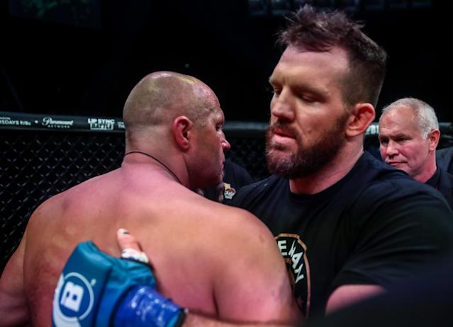 Fedor Emelianenko (L) and Ryan Bader hug it out after their heavyweight bout at the Forum in Inglewood, California. (Getty Images)