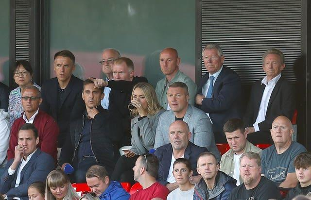 Phil Neville, fourth left,, Gary Neville, fifth left, Paul Scholes, centre left, and Nicky Butt, centre