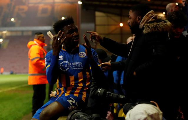"Soccer Football - League One - Bradford City vs Shrewsbury Town - Northern Commercials Stadium, Bradford, Britain - April 12, 2018 Shrewsbury Town's Aristotle Nsiala with fans at the end of the match Action Images/Lee Smith EDITORIAL USE ONLY. No use with unauthorized audio, video, data, fixture lists, club/league logos or ""live"" services. Online in-match use limited to 75 images, no video emulation. No use in betting, games or single club/league/player publications. Please contact your account representative for further details."