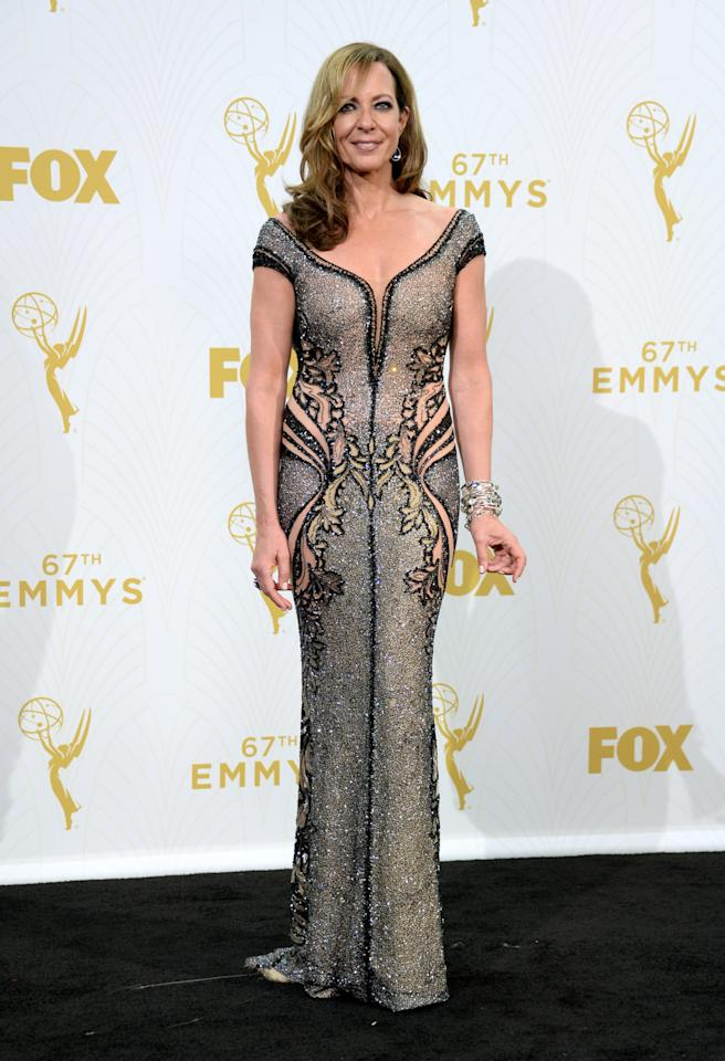Allison Janney in a sheer and sequin dress.
